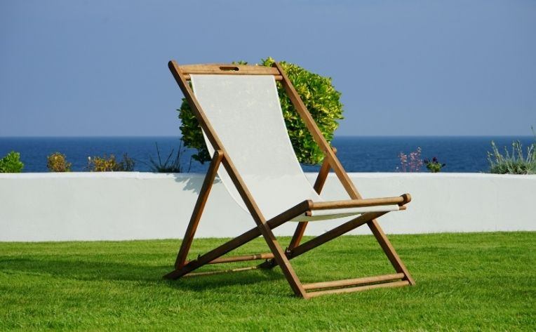 Turf Showing Chair with Beach Background