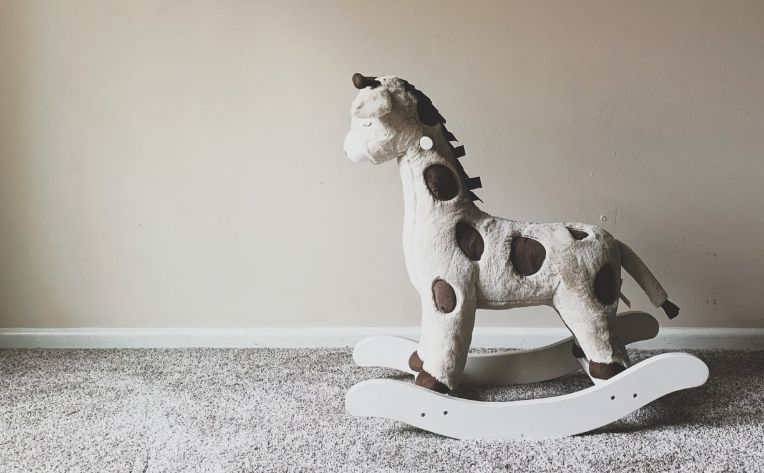 Toy Horse for Kid on Carpet Flooring